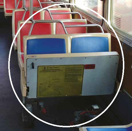 Picture with the first row of forward facing seats circled, to indicate that these are the seats which are being modified.