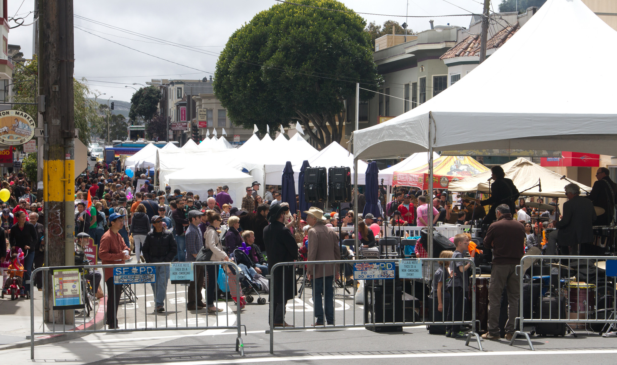 People gathered around a sound stage at a street festival