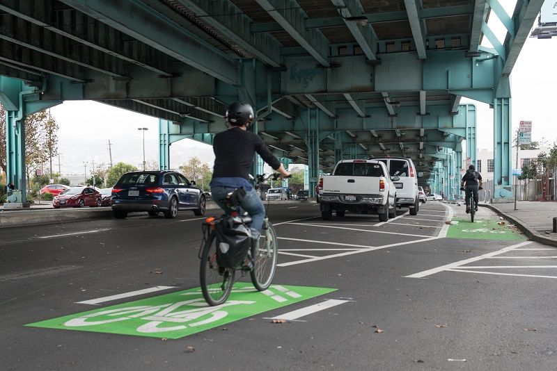 Parking-protected bike lane on 13th Street under the Central Freeway.