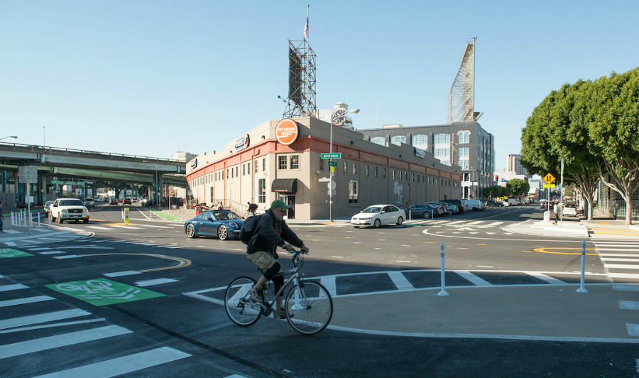 A man bikes through the newly upgraded intersection of 9th and Division.