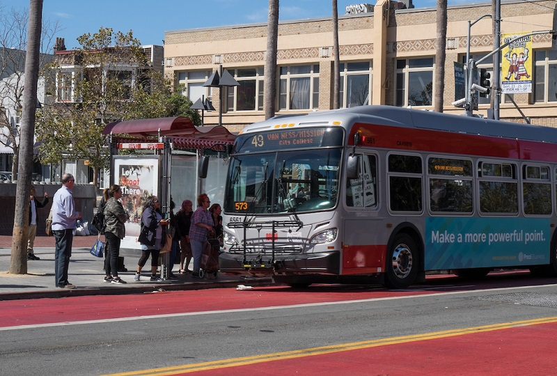People board a Muni bus on Mission Street.
