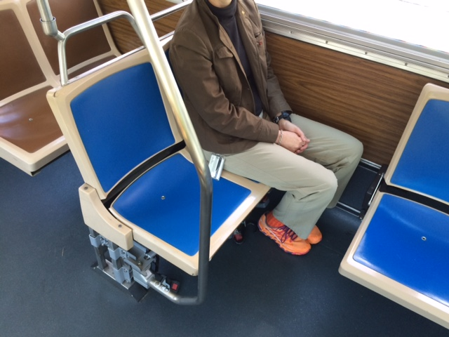 Woman sitting down in lowered seats.