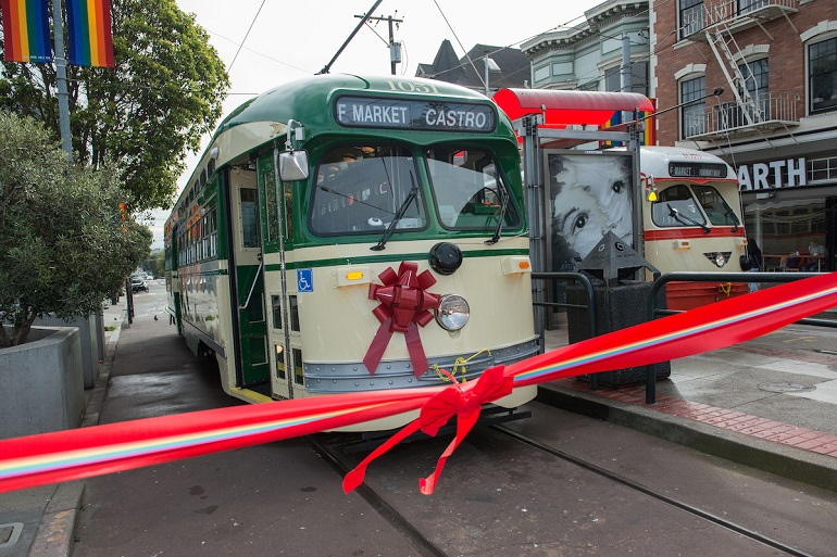 Creme and Green Livery Street with a red bow on the front behind a red ribbon.