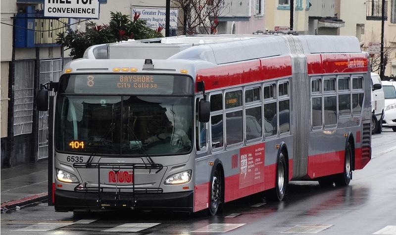 An 8 Bayshore Muni bus traveling on San Bruno Avenue.