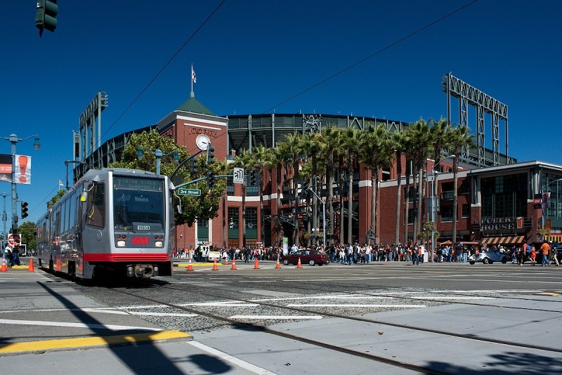 Muni light rail vehicle passes in front of AT&T Park.