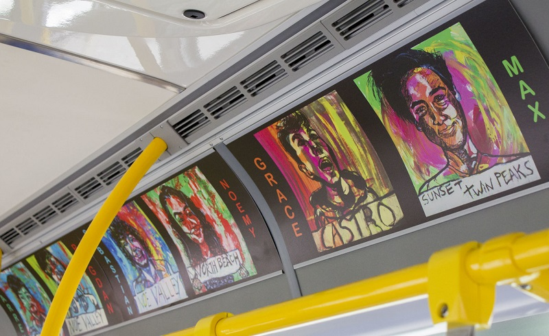Artwork displayed in advertisement slots on a Muni bus.