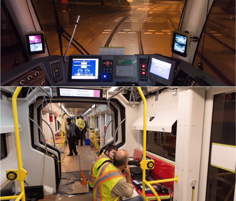 View inside the operator cab on the test train. SFMTA train engineers and other staff aboard the train.