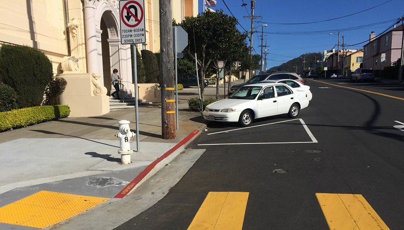 "A corner on Vicente Street with existing ""front-in"" angled parking and ""daylighting."""