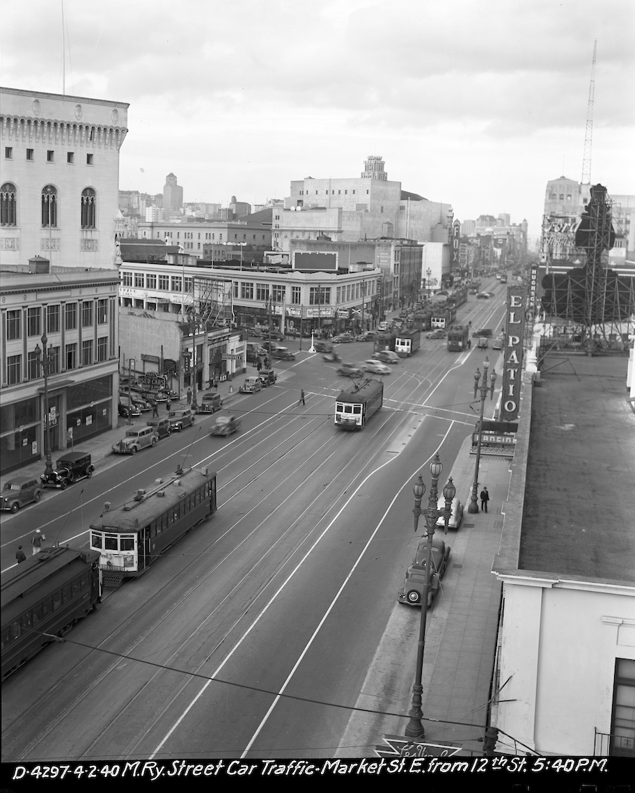 overhead view looking east on market with streetcar and auto traffic buildings and pedestrians