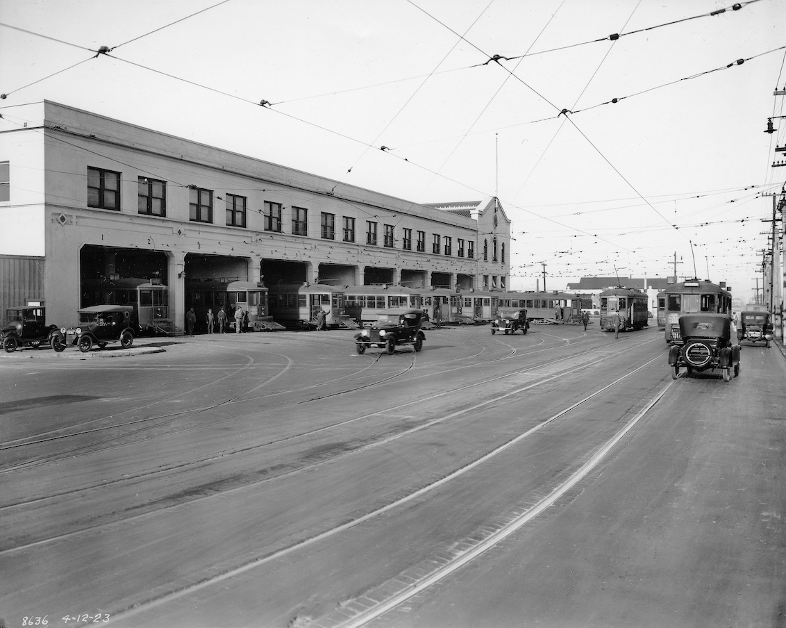 streetcars and automobiles outside geary carhouse