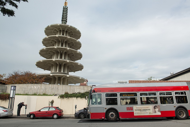 A 38 coach stopping outside of Japantown.