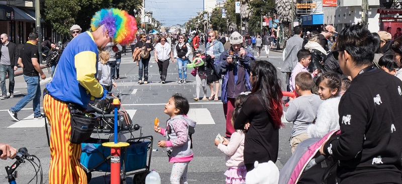 People having fun at Sunday Streets in the Mission.