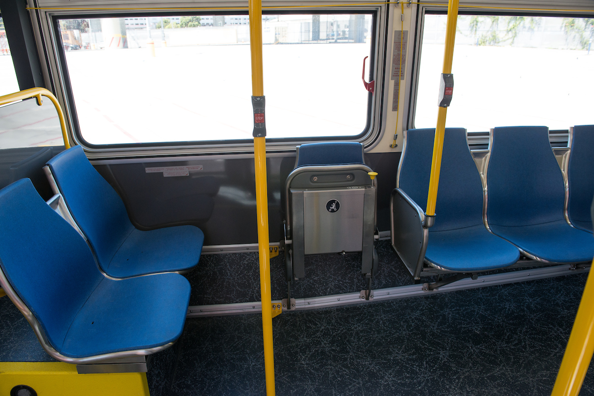 Photo of dedicated wheelchair space on New Flyer buses.