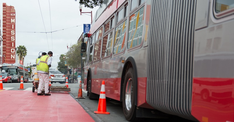 Crews putting down red transit lanes in the Mission