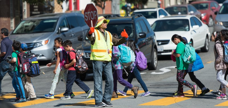 Kids crossing the street with crossing guard