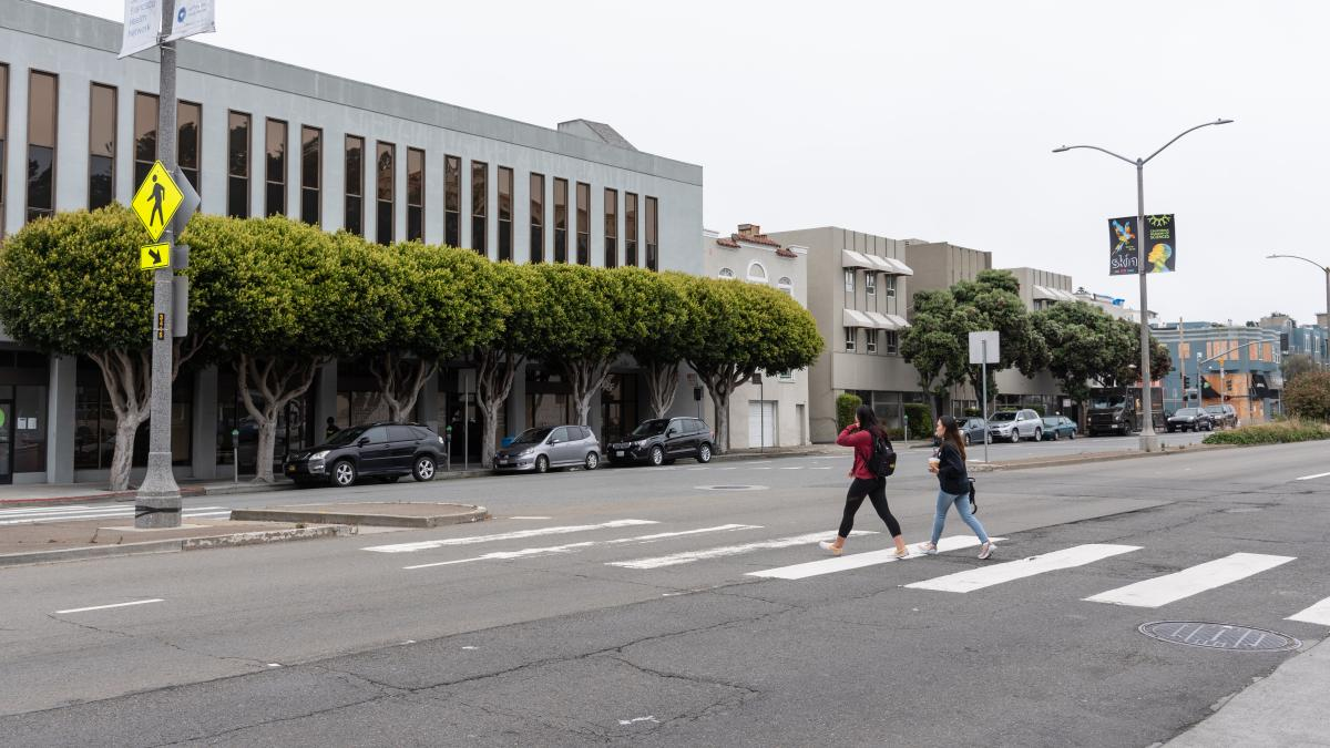 Image shows pedestrians crossing Geary and Commonwealth/Beaumont