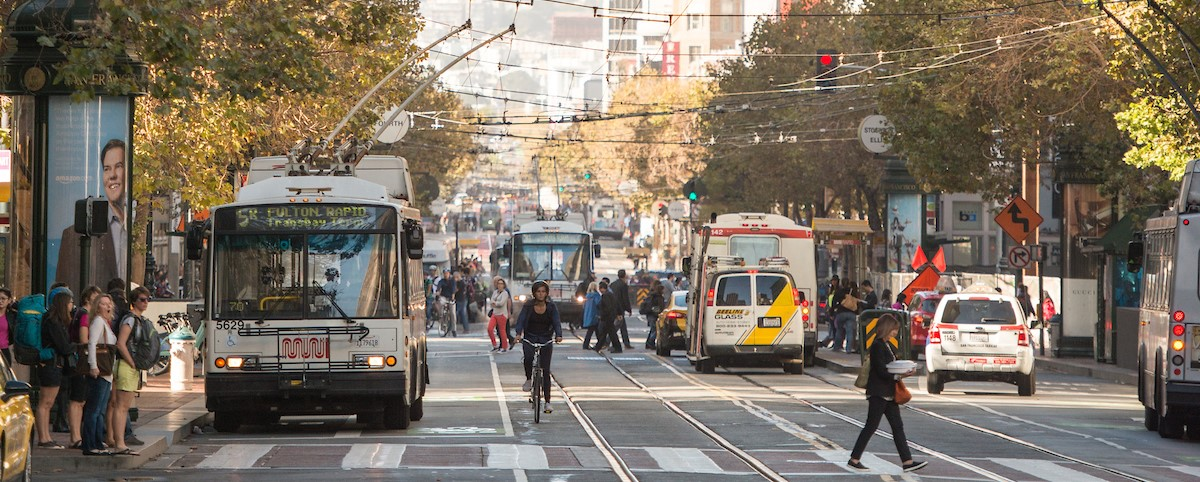 buses, cars, cyclists and pedestrians