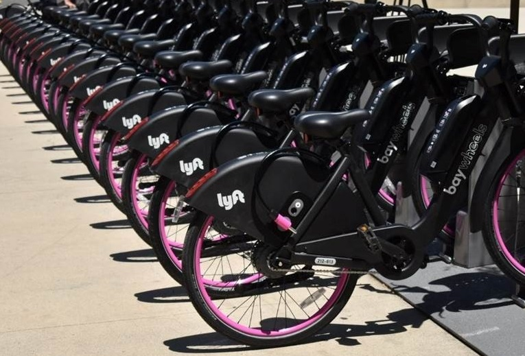 Row of black and pink Lyft bike share bikes