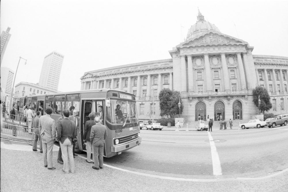 bus and people outside SF City Hall