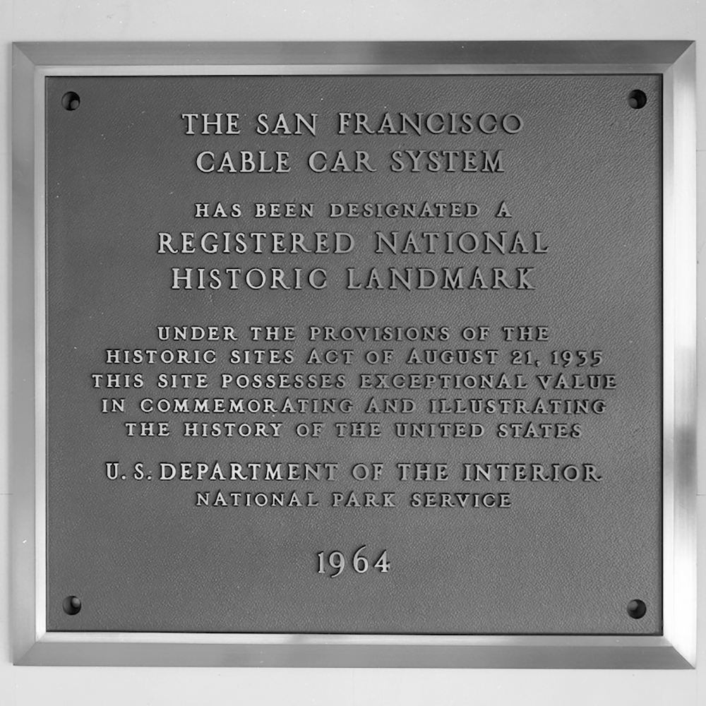 plaque for cable car national landmark status.  Plaque reads: The San Francisco Cable Car System has been designated a Registered National Historic Landmark  Under the provisions of the historic sites act of August 21, 1935, this site possesses exceptional value in commemorating and illustrating the history of the United States. U.S. Department of the Interior, National Park Service, 1964