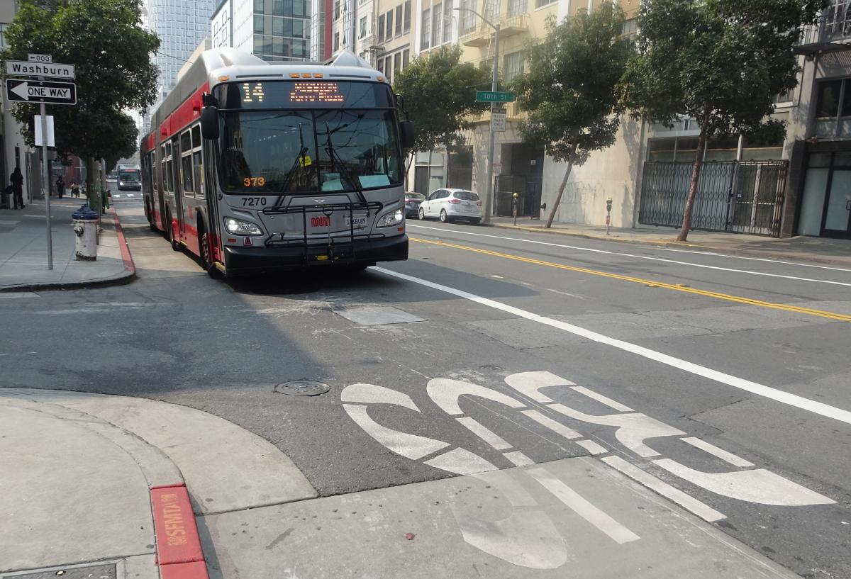 14 Mission bus driving on Mission Street in transit lane