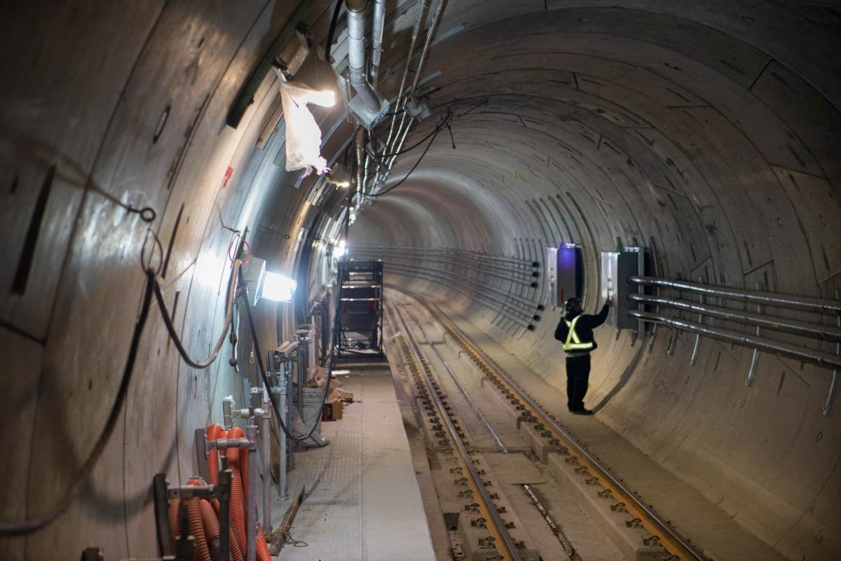 Conduits for electrical, communications, and signaling systems, are being installed inside the northbound tunnel.