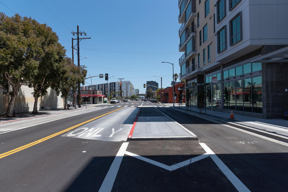 A new center-running transit lane with boarding island on 16th Street. Soon, the lane will be upgraded with red paint, and a shelter and railings will be installed on the island to complete the project.
