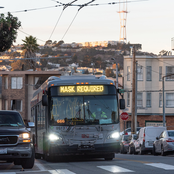 "A Muni bus with a ""Mask Required"" head sign."