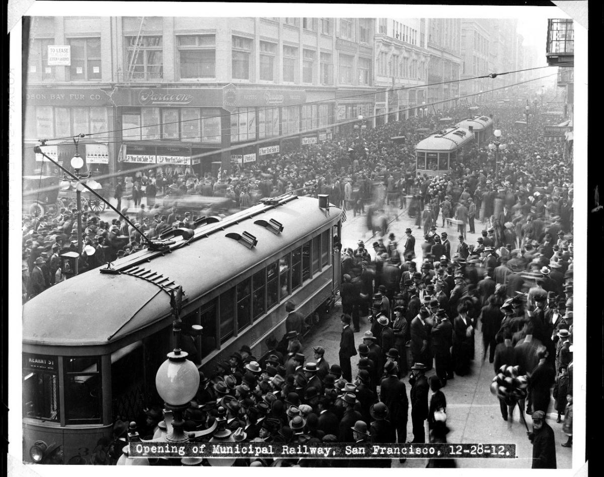 Photo of crowd surrounding two Muni streetcars in downtown San Francisco in 1912