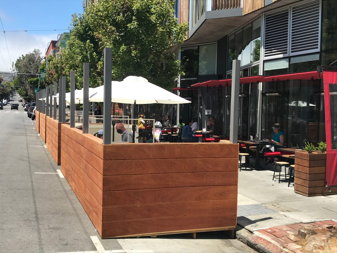 A shared space in front of a Mano restaurant