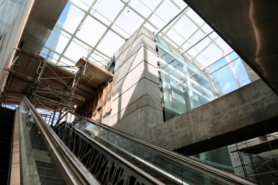 Lots of natural light and exposed concrete from the skylights for the entrance underground at Yerba Buena/Moscone Station.