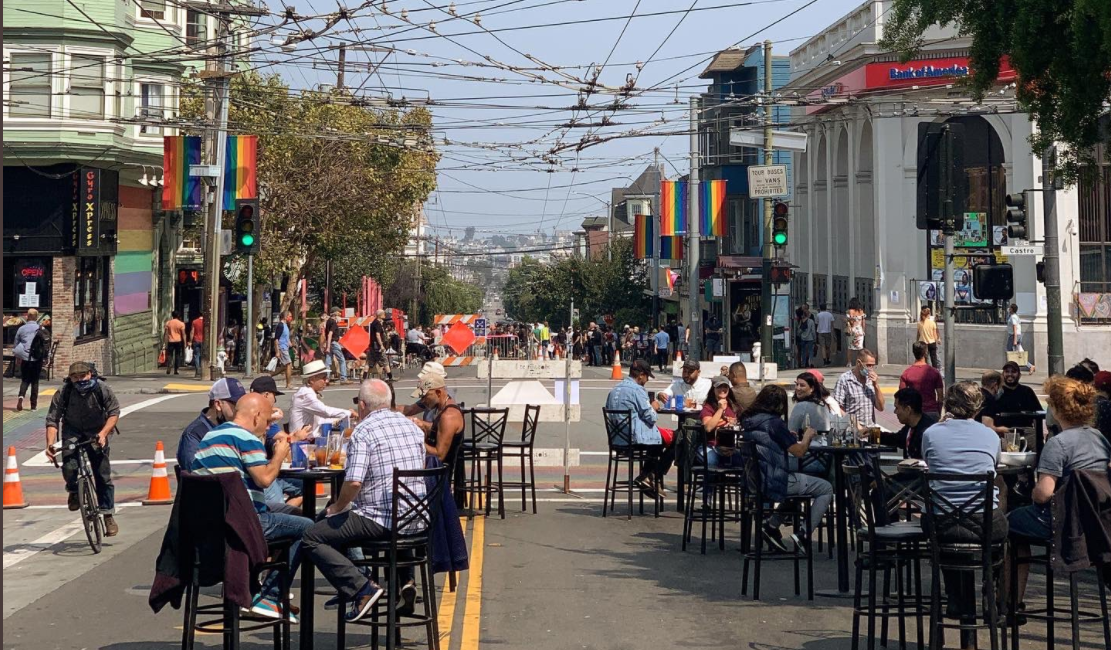 Photo of people enjoying the Shared Space at 18th and Castro