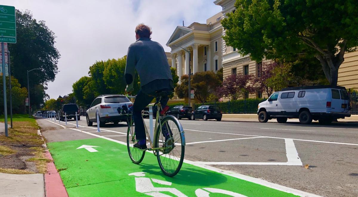 man biking on Fell Street bike path