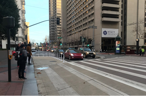 "A new khaki-colored ""painted safety zone"" recently added at Drumm and Market will reduce conflicts and shrink street crossing distances for people walking."