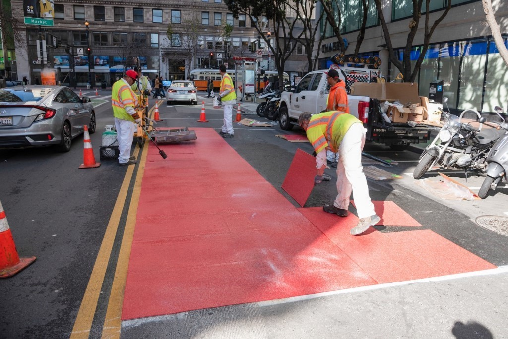 Red Muni lanes getting installed along 2nd Street near Market.