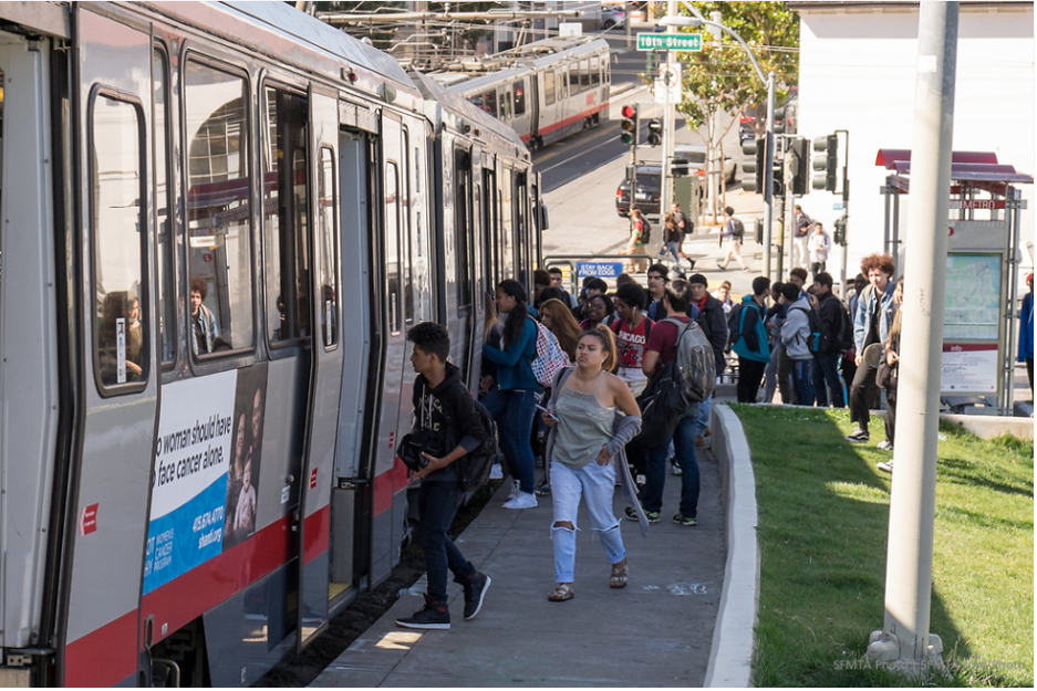 Photo of San Francisco youth lining up to board a Muni vehicle
