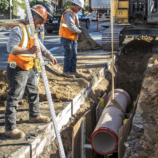 Image of crews installing new sewer mains