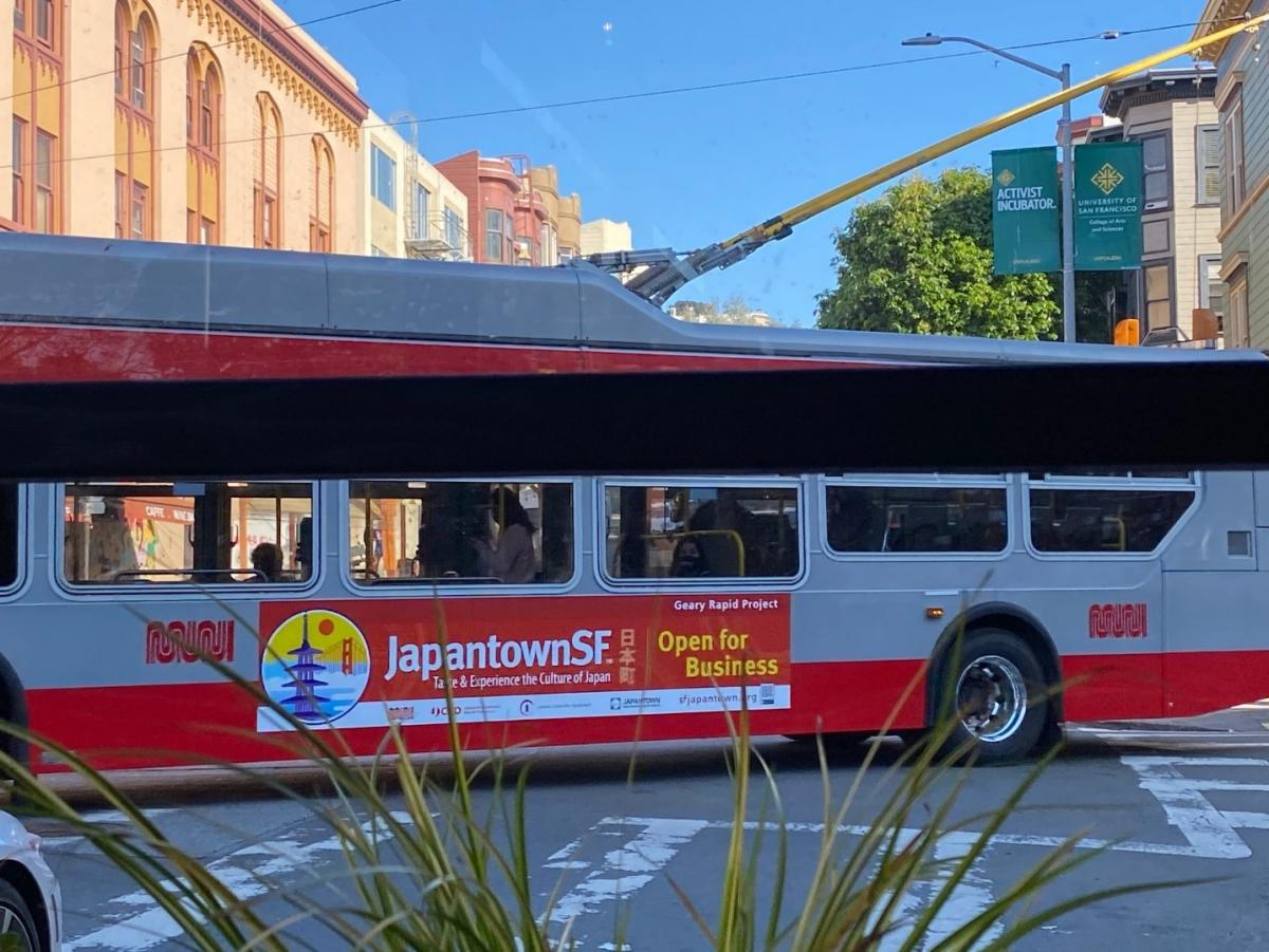 Photo of bus with ad produced for Japantown as part of the Geary Rapid Project Business Support Program
