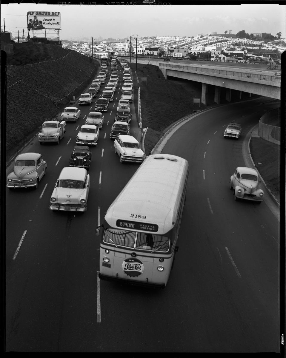 A Muni 15 3rd & Kearny bus makes a lane change on San Bruno & Harkness avenues in this 1957 photo.