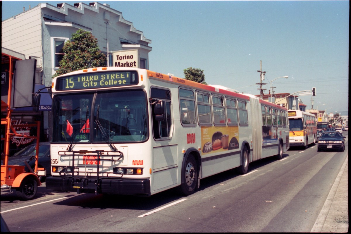 A 15 Third Street coach passes Torino Market at 3rd and Palou on its way out to City College in 2002.