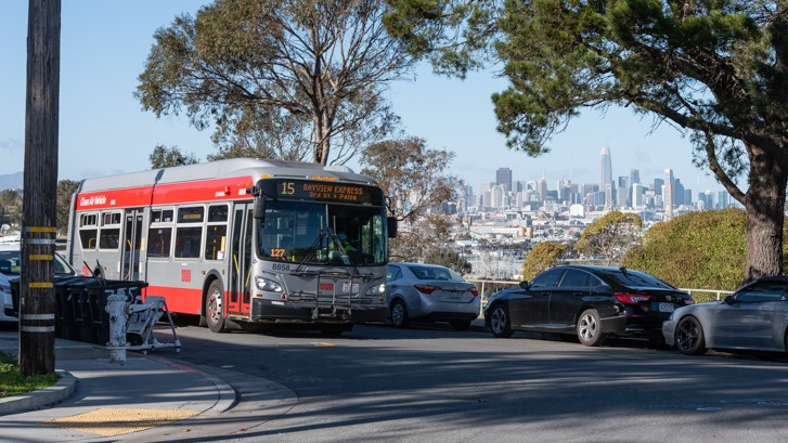 A 15 Bayview Hunters Point Express coach passes a city vista along Jerrold Ave in the Hunter's Point neighborhood on January 25, 2021.