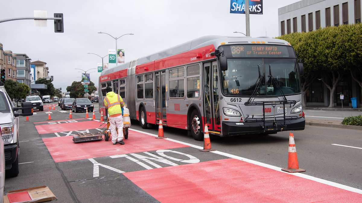 Photo of crew striping street with red paint on Geary