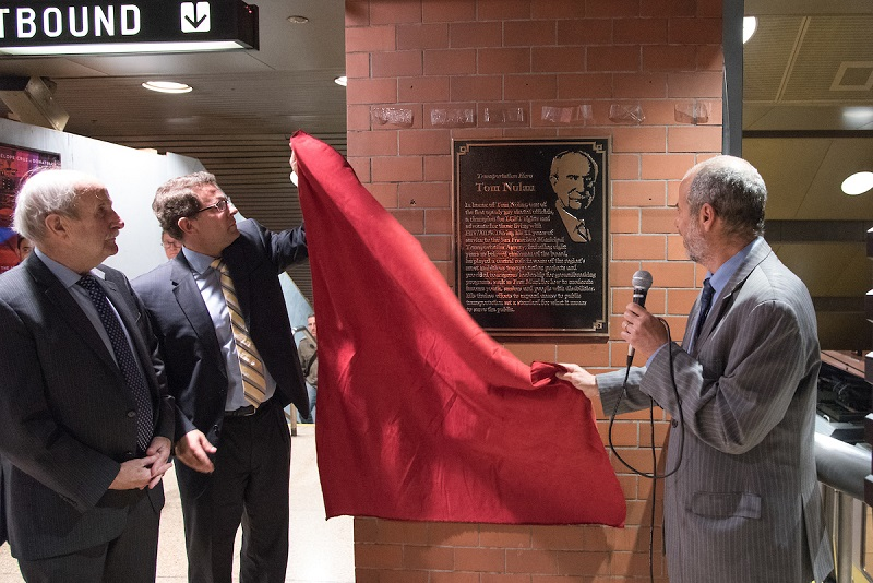 Tom Nolan and Ed Reiskin removing red curtain from plaque