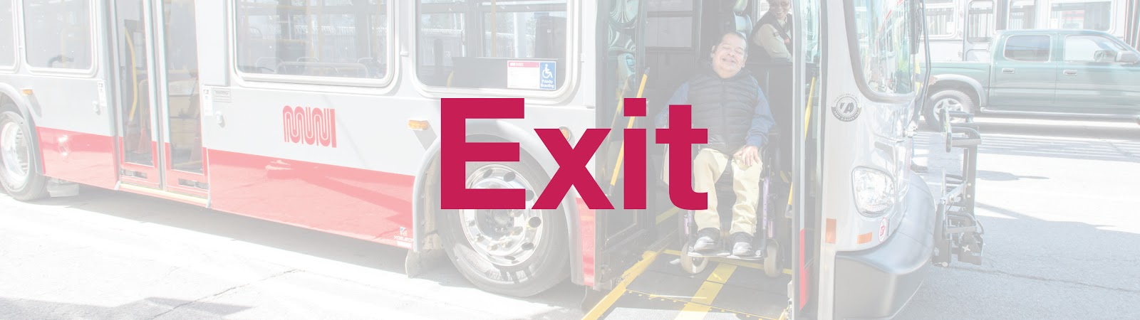 Exit: Image: A customer in a wheelchair alighting from a Muni bus.