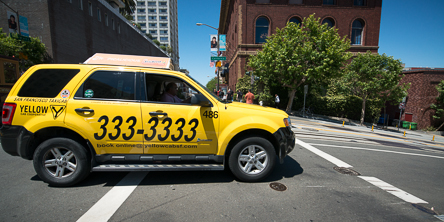 A Yellow Cab heads downhill on California Street | May 20, 2013