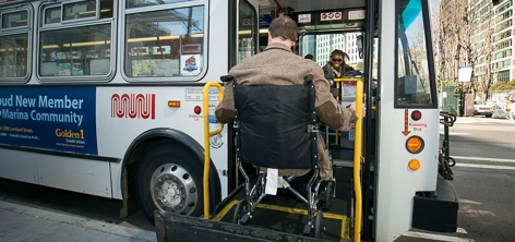 Passenger uses wheelchair lift on a Muni bus | March 11, 2013