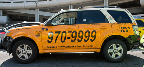 Car with Town Taxi company color scheme