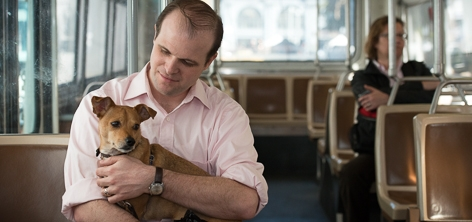 Passenger holds a diabetic alert dog while on a Muni Bus | March 12, 2013