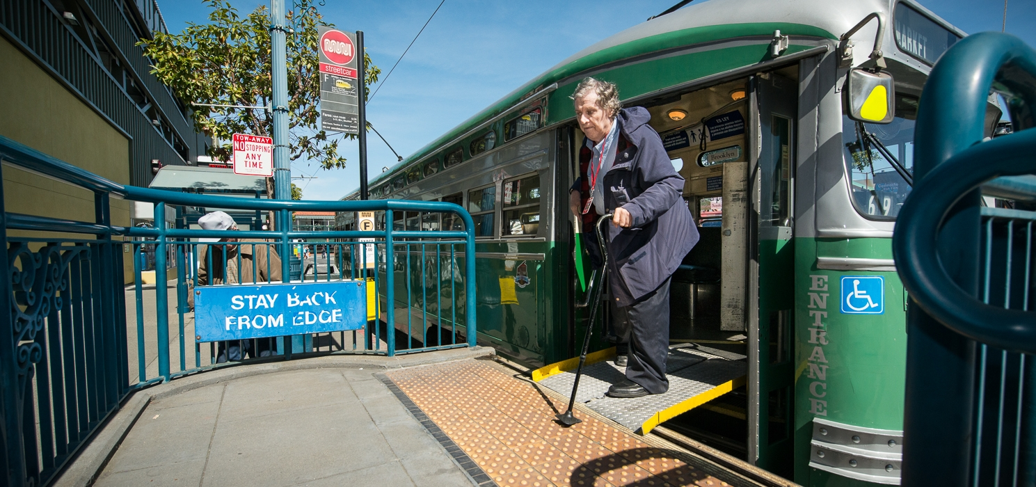Passenger exits a streetcar onto the ramp