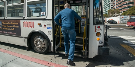 Senior Passenger Steps onto Kneeler Bus